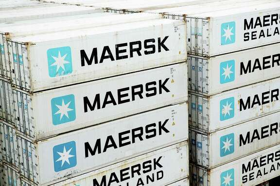 FILE - In this Jan. 31, 2014, file photo of A.P. Moller-Maersk containers on a ship in the Panama Canal. Denmark's A.P. Moller-Maersk A/S is splitting its container shipping and energy operations into two independent entities as part of a major shakeup. The Copenhagen-based group said Thursday Sept. 22, 2016 that the transport and logistics division will include its shipping, terminal and container businesses, while the energy division will handle oil drilling and production as well as the tanker business. (Thomas Borberg/Polfoto via AP,file)