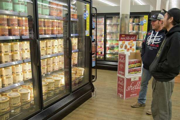 Steve Morris and son Dylan look over Blue Bell choices late last year after the ice cream was restocked on the shelves of Midland stores. Tim Fischer\Reporter-Telegram