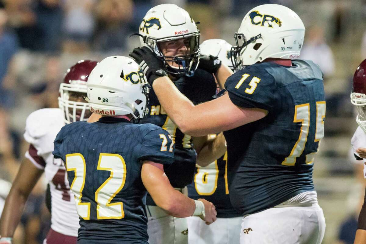 Cy-Ranch players Holden Gourley (22), Blake Nevins (11), and Samir Martula (75) celebrate after Nevins' touchdown late in the fourth quarter of a high school football game at Cy-Fair FCU Stadium on Thursday, September 22, 2016, in Houston.