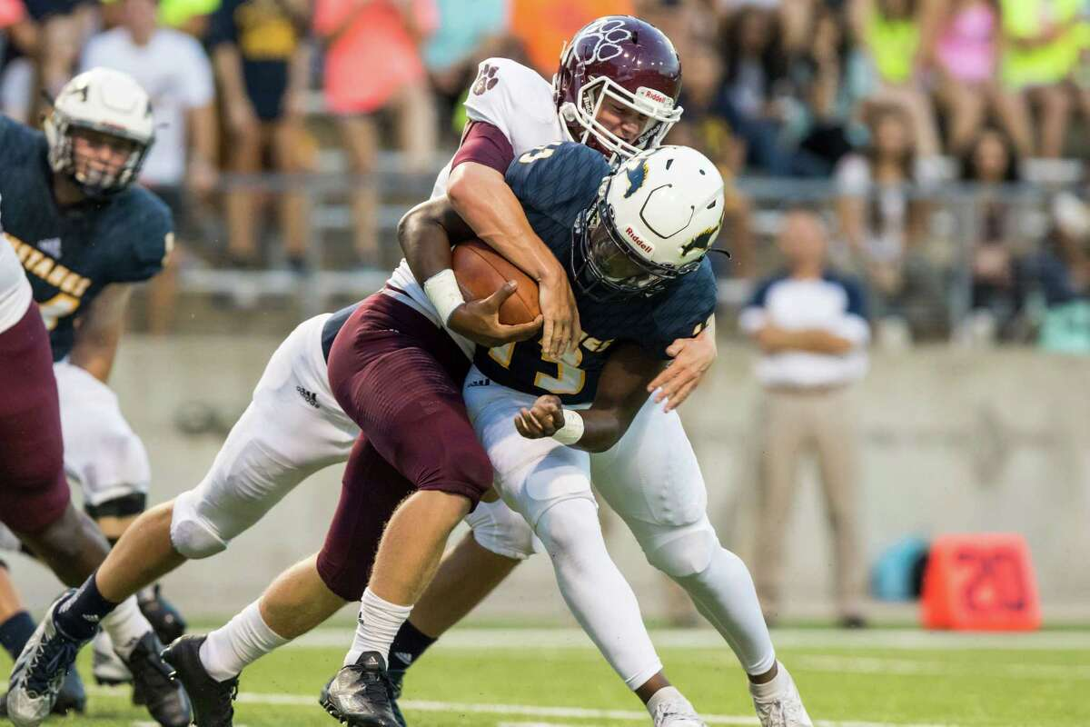 Cy-Ranch quarterback Austin Goffney (13) is sacked by a Cy-Fair defensive player in a high school football game at Cy-Fair FCU Stadium on Thursday, September 22, 2016, in Houston.
