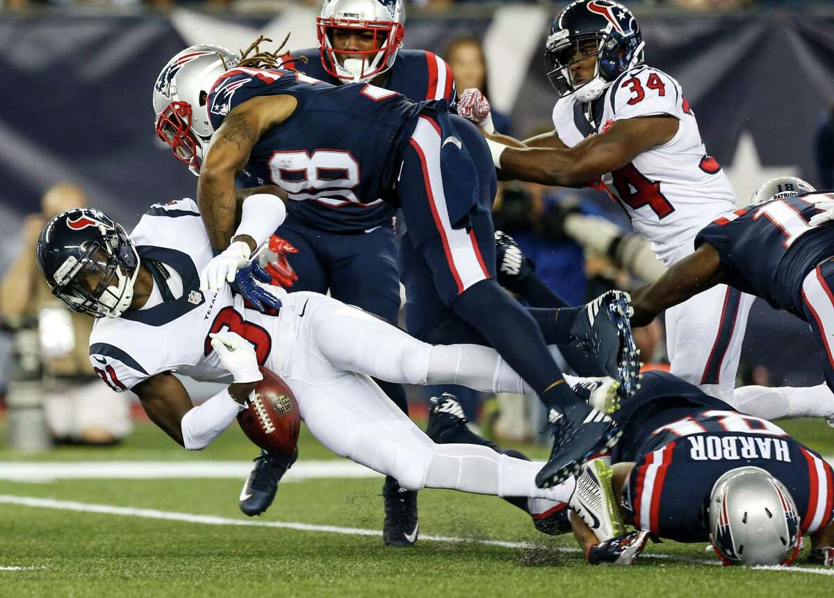 Houston Texans defensive back Charles James (31) fumbles as he is hit by New England Patriots running back Brandon Bolden (38) on a kick return during the first quarter of an NFL football game at Gillette Stadium on Thursday, Sept. 22, 2016, in Foxborough, Mass.