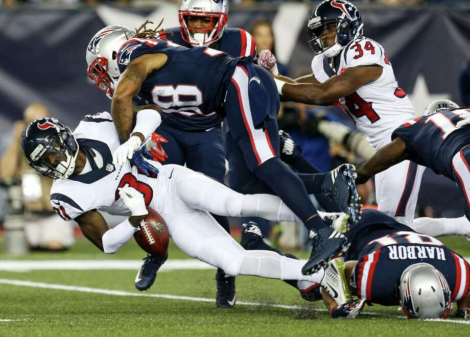 Houston Texans defensive back Charles James (31) fumbles as he is hit by New England Patriots running back Brandon Bolden (38) on a kick return during the first quarter of an NFL football game at Gillette Stadium on Thursday, Sept. 22, 2016, in Foxborough, Mass. Photo: Brett Coomer, Houston Chronicle / © 2016 Houston Chronicle