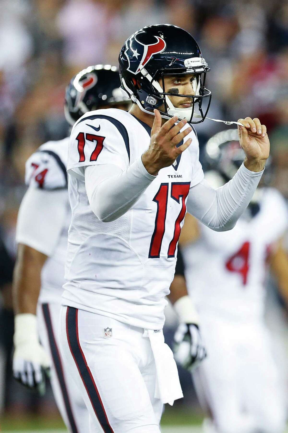 Houston Texans quarterback Brock Osweiler (17) reacts while coming off the field during the fourth quarter of an NFL football game at Gillette Stadium on Thursday, Sept. 22, 2016, in Foxborough, Mass.