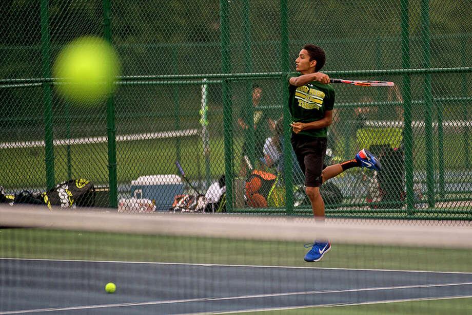 ERIN KIRKLAND | ekirkland@mdn.net  Dow's Anish Middha returns a serve during his No. 2 singles match on Thursday at H.H. Dow High School.