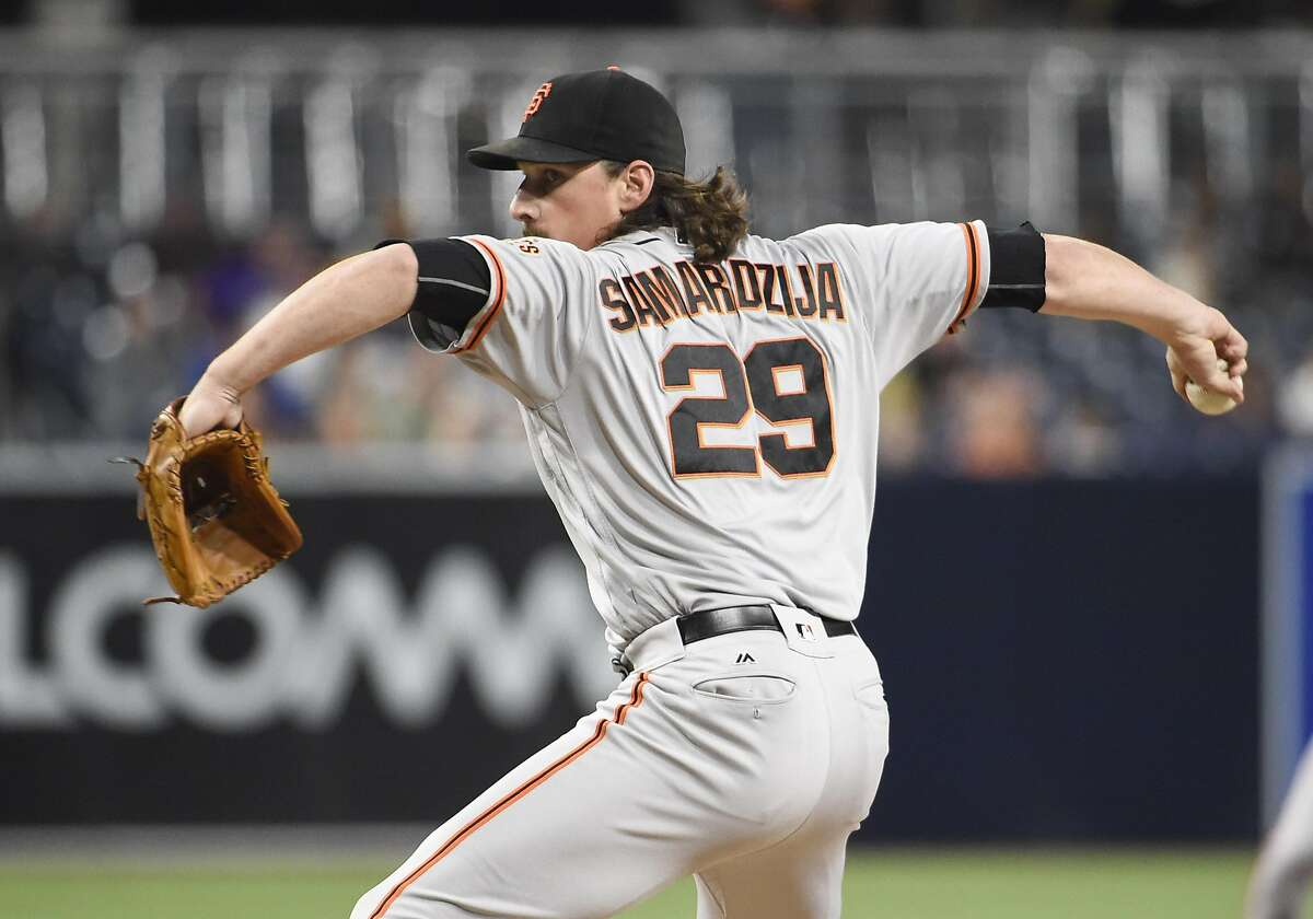SAN DIEGO, CALIFORNIA - SEPTEMBER 22: Jeff Samardzija #29 of the San Francisco Giants pitches during the first inning of a baseball game against the San Diego Padres at PETCO Park on September 22, 2016 in San Diego, California. (Photo by Denis Poroy/Getty Images)