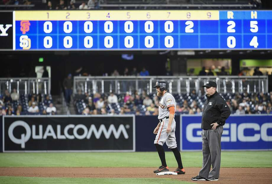 Start off extra innings with a runner on second base? Really? Photo: Denis Poroy, Getty Images