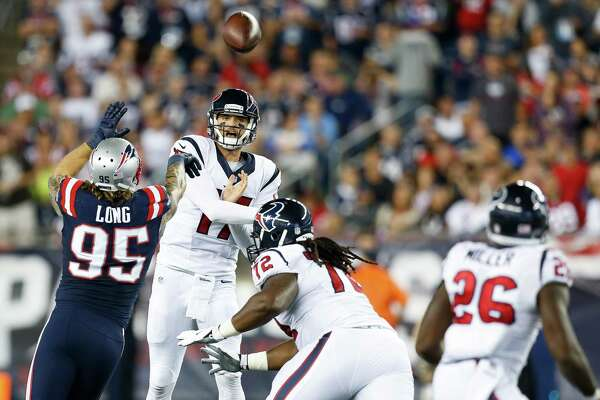 Houston Texans quarterback Brock Osweiler (17) makes a pass over New England Patriots defensive end Chris Long (95) during the second quarter of an NFL football game at Gillette Stadium on Thursday, Sept. 22, 2016, in Foxborough, Mass. ( Brett Coomer / Houston Chronicle )