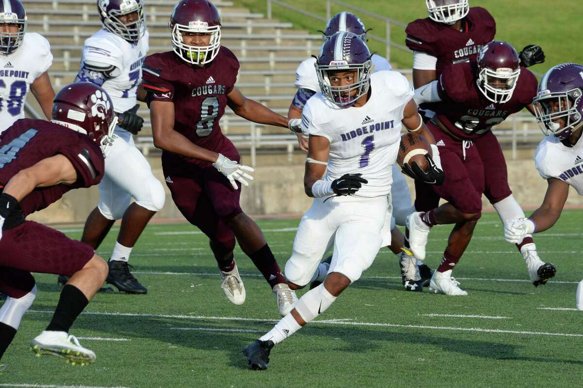 Terry Petry (1) of the Panthers gains 7 yards on a run in the first quarter of a high school football game between the Kempner Cougars and Ridge Point Panthers on September 22, 2016 at Mercer Stadium, Sugar Land, TX.