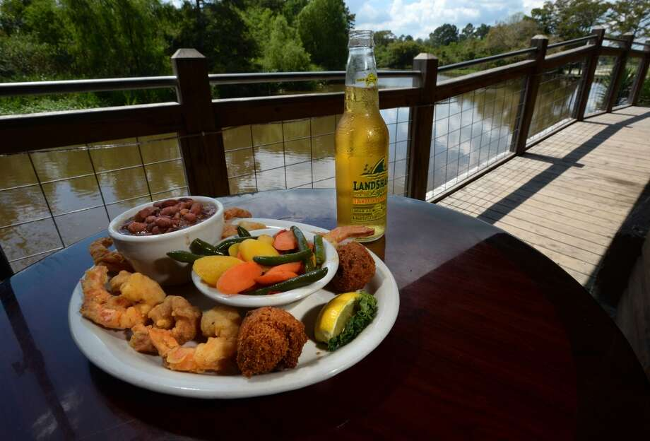Fried shrimp and vegetables with beans and rice at the Pine Tree Lodge on Wednesday. Photo taken Wednesday, September 14, 2016 Guiseppe Barranco/The Enterprise Photo: Guiseppe Barranco/The Enterprise