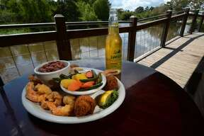 Fried shrimp and vegetables with beans and rice at the Pine Tree Lodge on Wednesday. Photo taken Wednesday, September 14, 2016 Guiseppe Barranco/The Enterprise