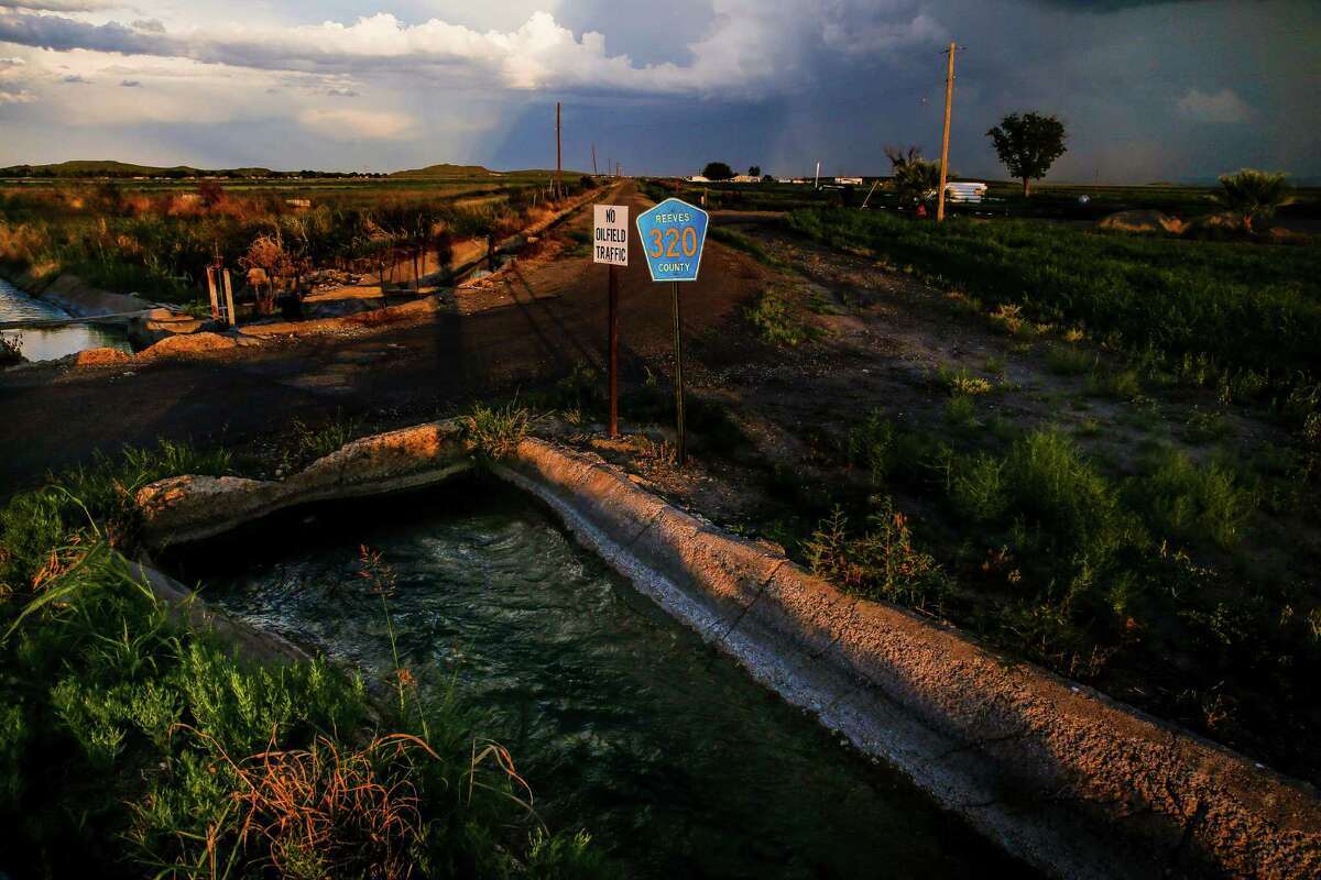 A canal runs from the natural springs at Balmorhea State Park. Apache Corp. estimates that its find in the area holds more than 3 billion barrels of oil and 75 trillion cubic feet of natural gas.