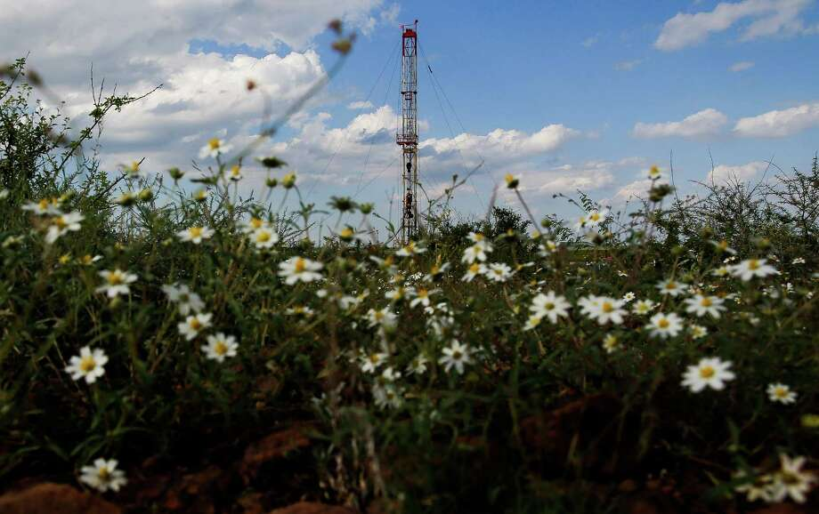 A drilling rig sits north of the Davis Mountains Friday, Sept. 16, 2016 in Balmorhea. Houston-based Apache Corporation recently announced the discovery of an estimated 15 billion barrels of oil and gas in the area and plans to drill and use hydraulic fracturing on the 350,000 acres surrounding the town. Apache has leased the mineral rights under the town and nearby state park, but has promised not to drill on or under either. While some residents worry that the drilling could affect the spring at the state park and impact tourism, others are excited for the potential economic boom the oil discovery and drilling could bring. ( Michael Ciaglo / Houston Chronicle ) Photo: Michael Ciaglo, Staff / © 2016  Houston Chronicle