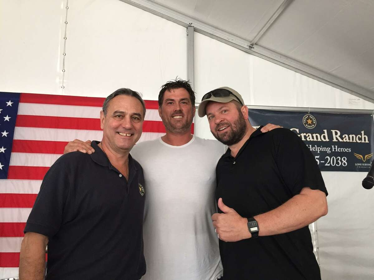 From left are Gary Sumner, managing partner at Texas Grand Ranch; Marcus Luttrell, founder of Lone Survivor Foundation; and Michael Berry, radio host for KTRH Houston.