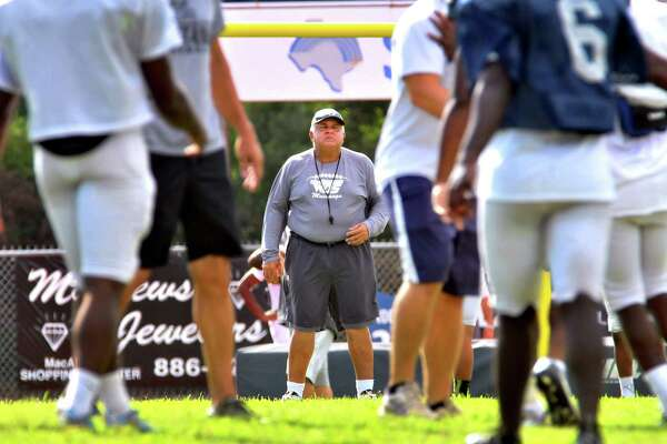 West Orange-Stark coach Cornel Thompson watches as the special team units run through practice Thursday at Dan R. Hooks Stadium. The Mustangs face the Silsbee Tigers tonight. (Mike Tobias/The Enterprise)