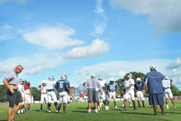 West Orange-Stark coach Cornel Thompson speaks to defensive members after the field goal unit kicked during practice at Dan R. Hooks Stadium. The Mustangs host the Silsbee Tigers tonight. (Mike Tobias/The Enterprise)