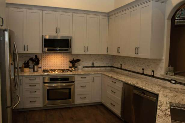 Gray cabinets were used in a Pearland kitchen by My Cabinet Source.