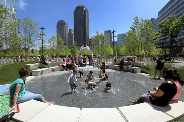 Children play in interactive fountains at Klyde Warren Park in downtown Dallas.