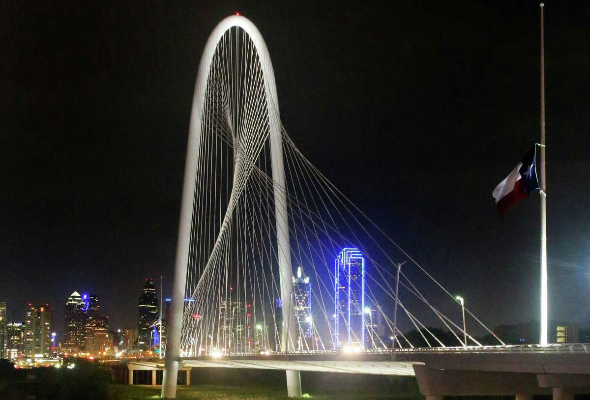 The Texas flag (right) rests at half staff on the Margaret Hunt Hill Bridge in Dallas in July.