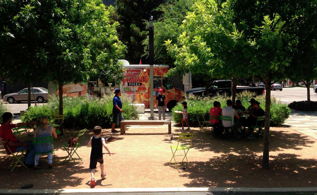 A food truck is pulled up beside Klyde Warren Park in Dallas in June.