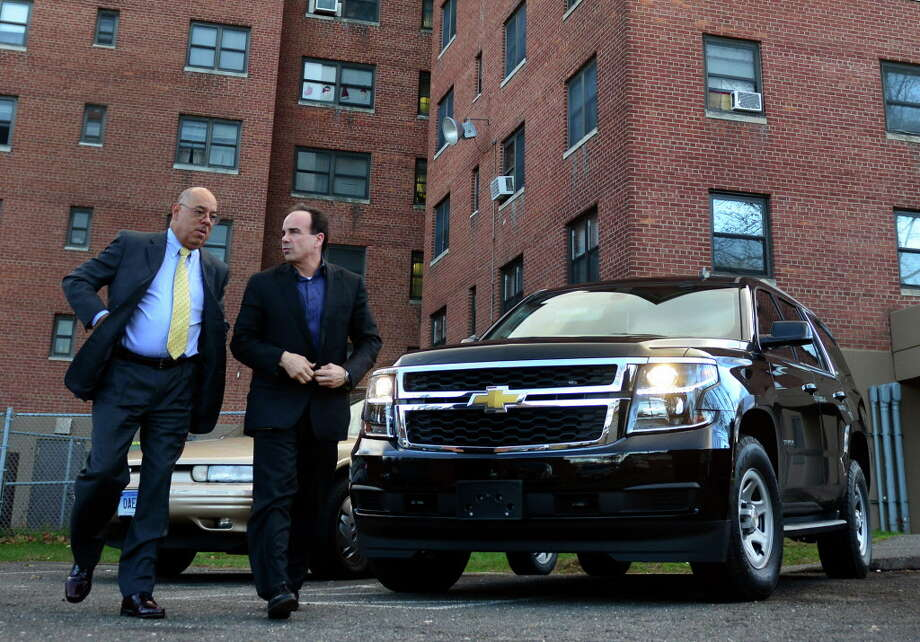 Mayor Joe Ganim arrives at the Trumbull Gardens Housing Complex with former Bridgeport Police Chief Wilbur Chapman in Bridgeport Photo: Christian Abraham / Hearst Connecticut Media / Connecticut Post