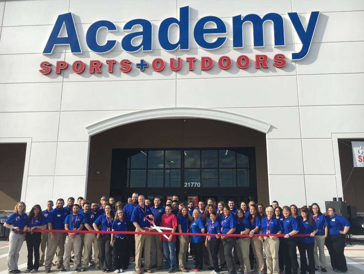 Academy Sports + Outdoors officials and employees cut the ribbon to the new store in New Caney.