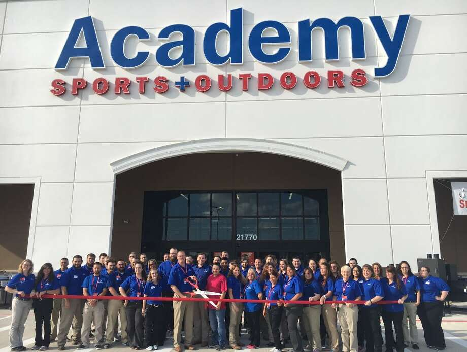 Academy Sports + Outdoors officials and employees cut the ribbon to the new store in New Caney. Photo: Academy Sports + Outdoors, Contributed Photo