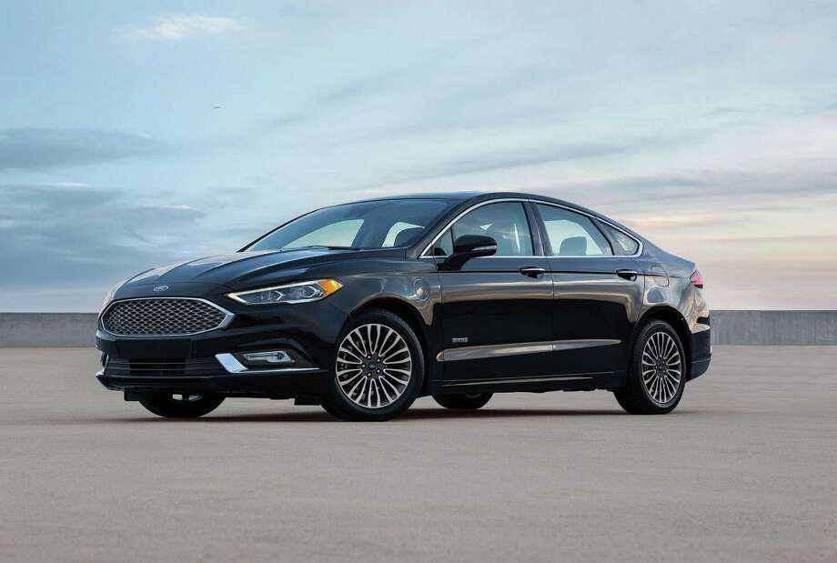 The 2017 Fusion Energi Platinum Has Standard Acoustic Windshield And Front Windows Led Headlights