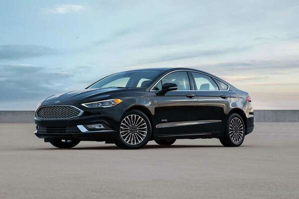 The 2017 Fusion Energi Platinum has standard acoustic windshield and front windows, LED headlights and fog lights with automatic high beams, front crash prevention with pre-collision assist and pedestrian detection. This Energi has the optional 18-inch alloy wheels.