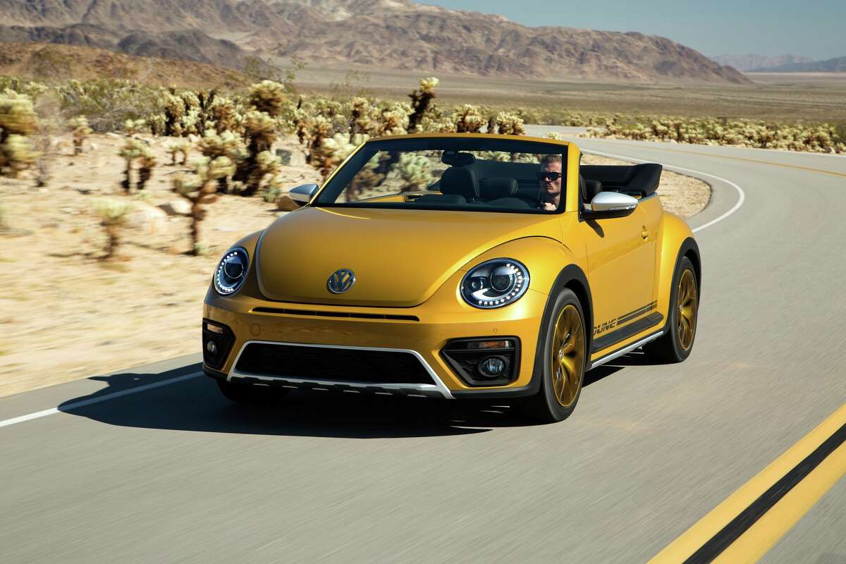 Distinctive exterior elements include a slightly elevated (0.4-inch) ride height, a 0.6-inch-wider track, 18-inch wheels (offered in gold as an option) and a honeycomb patterned front grille punctuated by a silver skid plate