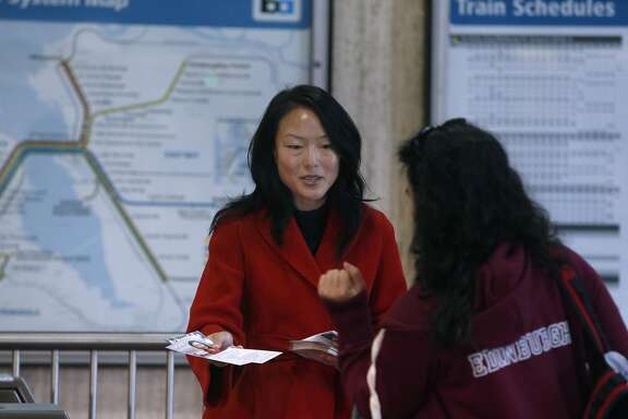Jane Kim hands out voter pamphlets to commuters at the Balboa Park BART station while campaigning for her race against Scott Wiener for the State Senate in San Francisco, Calif. on Thursday, Sept. 22, 2016.