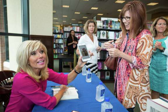 Author Beth Moore talks to Sharen Watson during a book signing Tuesday at Barnes & Noble in The Woodlands.