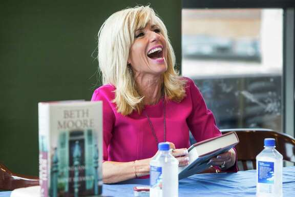Author Beth Moore laughs as she talks to fans as she signs her new book on its release day at Barnes & Noble on Tuesday, Sept. 20, 2016, in The Woodlands. Moore, a nationally known evangelical leader based in Houston, has just written her first novel. ( Brett Coomer / Houston Chronicle )