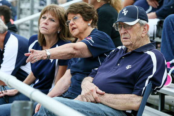 Ivan Snoga (from right), his wife Evelyn and daughter, Jill Moorman watch their grandson and son, Luke Moorman, play in a Smithson Valley junior-varsity football game against East Central at Ranger Stadium on Sept. 23, 2016. The Snogas have had 13 grandsons who have played or are currently playing football in the Smithson Valley program. Snoga sits with his family in the same spot in the stands every home game.