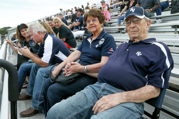 Ivan Snoga and his wife Evelyn watch their grandson, Luke Moorman, play in a Smithson Valley junior-varsity football game against East Central at Ranger Stadium on Sept. 23, 2016.