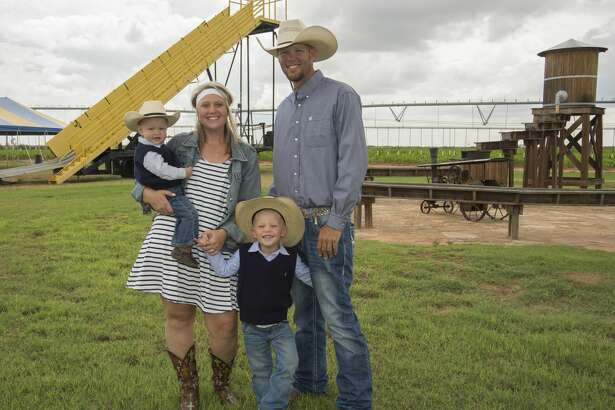 Jessica and Matt Norton with sons Trail, 4 and Crease, 1, at Fiddlesticks Farms. Tuesday 08-30-16 Tim Fischer/Reporter-Telegram