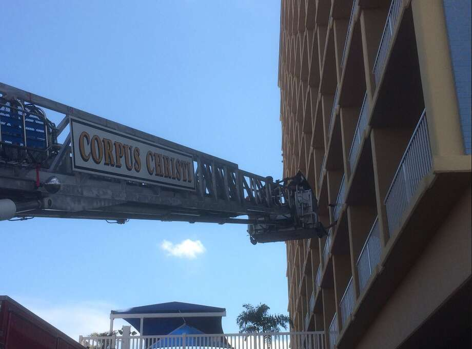 "@CorpusChristiPD: ""Corpus Christi Police and Fire Departments are working together to bring a woman to safety from and armed barricaded standoff downtown #PIO4"" Photo: Courtesy/Corpus Christi Police Department"