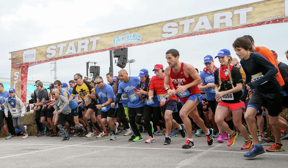 Runners take off at the start of the Corner Store Country Run, a 10-city 5K run series, at the Freeman Coliseum on Nov. 14, 2015. Photo: Marvin Pfeiffer /San Antonio Express-News / Express-News 2015