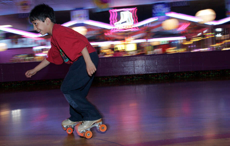 Anthony Alvarez, 9, speeds around the rink at the Rollercade, one of San Antonio's roller rinks. Photo: Express-News File Photo / SAN ANTONIO EXPRESS-NEWS