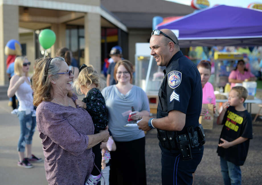 MPD Community Relations Sgt. Jimmy Young talks with Kelly Smith and 2-year-old Grace Wiggins during a National Night Out block party Tuesday, Oct. 6, 2015. James Durbin/Reporter-Telegram Photo: James Durbin