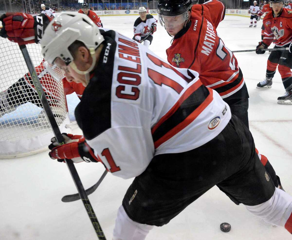 Albany Devils' #11 Blake Coleman battles Portland Pirates' #21 Michael Matheson behind the goal during Saturday's game at the Times Union Center Oct. 24, 2015 in Albany, NY. (John Carl D'Annibale / Times Union)