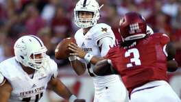 Texas State's Tyler Jones looks to pass during the first quarter against Arkansas on Sept. 17, 2016, in Fayetteville.