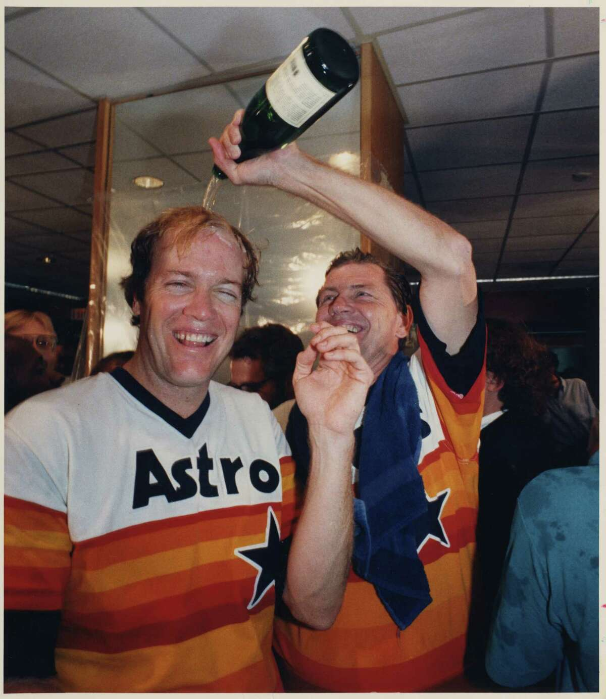 09/25/1986-- Houston Astros manager Hal Lanier pours champagne over Mike Scott, whose no-hitter clinched the NL west.