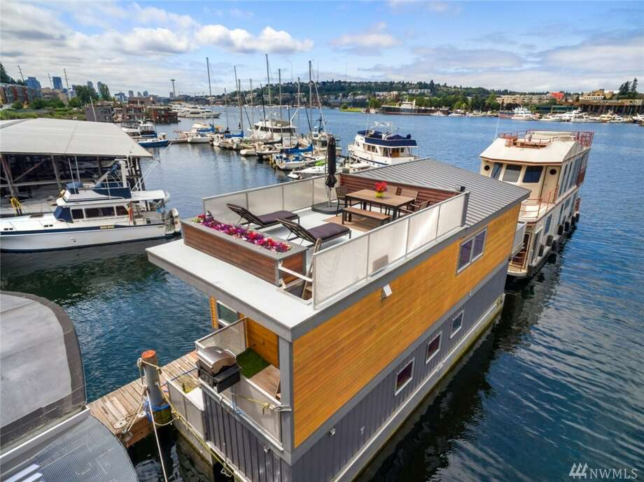 The first floating home, at 11 E. Allison St. #3, is listed for $899,000. The home has two bedrooms, 1½ bathrooms, a wet bar and a built-in fireplace. It was custom-designed and built in 2007.There will be a showing for this home on Sunday, Sept. 25 from noon to 3 p.m. You can see the full listing here. Photo: Photos By Exposio, Listing Courtesy Of Jonathan Villalobos, RE/MAX Eastside Brokers, Inc.