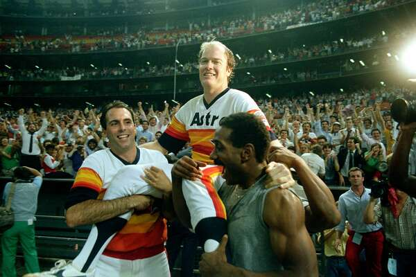 Houston Astros pitcher Mike Scott is carried by teammates Jim Deshaies, left, and Kevin Bess after his no-hitter game against the San Francisco Giants in the Houston Astrodome in Houston, Texas, Sept. 25, 1986.  The Astros won 2-0 to clinch the National League Western division.  (AP Photo)