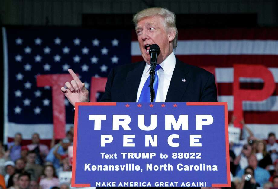 Republican presidential candidate Donald Trump speaks during a campaign rally in Kenansville, North Carolina. Readers offer passionate opinions about the race between Trump and Hillary Clinton. Photo: Evan Vucci /Associated Press / Copyright 2016 The Associated Press. All rights reserved.