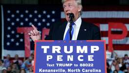 Republican presidential candidate Donald Trump speaks during a campaign rally in Kenansville, North Carolina. Readers offer passionate opinions about the race between Trump and Hillary Clinton.
