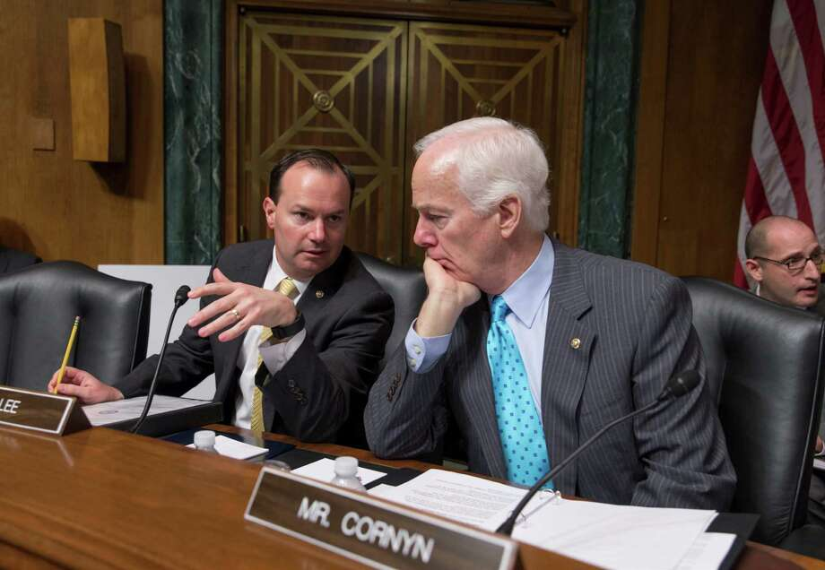 In this March file photo, Sen. Mike Lee, R-Utah, left, confers with Sen. John Cornyn, R-Texas. Hopes for overhauling the nations criminal justice system have faded in Congress this year, undercut the pressure of election-year politics. Photo: J. Scott Applewhite /Associated Press / Copyright 2016 The Associated Press. All rights reserved.