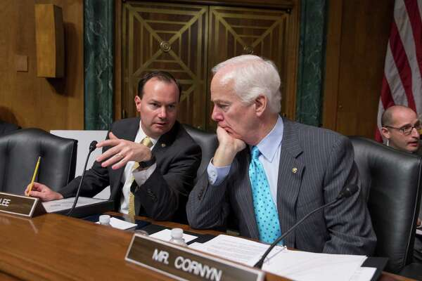 In this March file photo, Sen. Mike Lee, R-Utah, left, confers with Sen. John Cornyn, R-Texas. Hopes for overhauling the nations criminal justice system have faded in Congress this year, undercut the pressure of election-year politics.