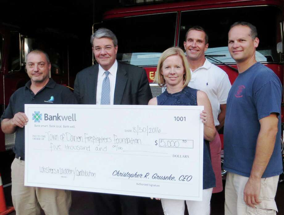 Bankwell donated $5,000 to the Darien Firefighters Foundation, which helps support the three volunteer fire companies that respond to over 1,000 calls per year. The foundation also raises funds to support the overall first responder capability in Darien. From left: Darien Fire Chief Vic Pensiero, Head of Community Banking at Bankwell David Dineen, Foundation President Brandi Maniscalco, Noroton Fire Capt. Jack Butcher, and Noroton Heights Fire Chief Shawn Murphy. Photo: Contributed Photo