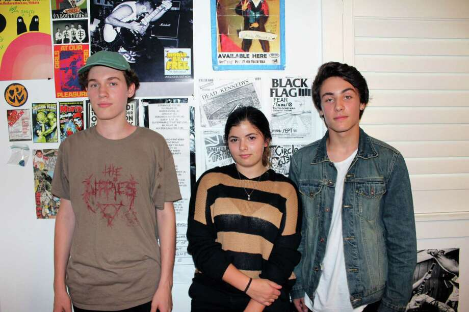 Punk rockers Grady Allen, left, Michelle Siegel and Sam Walter, teamed up to form the band Anxious. Photo: Justin Papp / Hearst Connecticut Media / Darien News